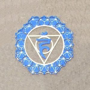 Throat chakra steel plate for use in meditation and healing and is part of a seven set with creams to match